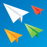 Paper planes. Flying in different directions in different colors Royalty Free Stock Photo