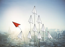 Paper planes on city bakcground. Abstract red and white paper planes flying on city background. Leadership and success concept. 3D Rendering stock illustration