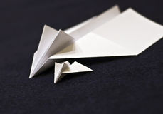 Paper planes family. Two paper planes, one bigger, and a  small one. A family idea presented. Focus on the small one Royalty Free Stock Photography