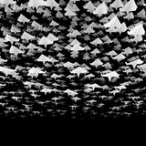 Paper planes flock. 3D illustration of hundreds of paper planes flying in loose formation Stock Photos