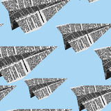 Paper planes seamless pattern on a blue background. Vector ornam Stock Image