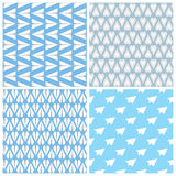 Paper Planes Seamless Pattern Set. Four Repeating Abstract Backgrounds with Paper Planes Symbol. Set of 4 paper planes seamless patterns. Repeating abstract Royalty Free Stock Images
