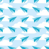 Paper planes on the sky with clouds seamless pattern. Airplanes vector Royalty Free Stock Photography