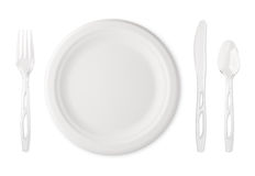 Paper Plate with Plastic Utensils. Place setting with paper plate and clear plastic utensils. The subject is isolated on white and includes a clipping path. The Royalty Free Stock Photo