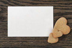 Paper post card with heart cookies Royalty Free Stock Images