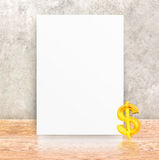Paper poster frame and black pencil at concrete wall and wooden Stock Photo