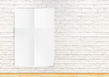 Paper poster hanging the white  brick wall and the wood floor,te Royalty Free Stock Images