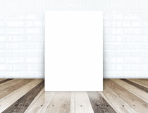 Paper poster on white ceramic tiles wall and tropical wood floor Stock Image