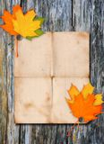 Paper poster on a wood wall Royalty Free Stock Photography
