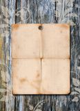 Paper poster on a wood wall Royalty Free Stock Photos