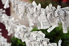 Paper Prayers. Tied on string at a Japanese Shinto Shrine in Kyoto stock photography