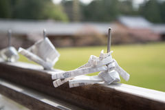 Paper prayers and wishes folded and tied at Todaiji temple. Nara, Japan Royalty Free Stock Image