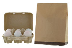 Paper pulp egg tray packages of fresh eggs next to brown recycle stock image