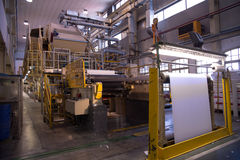 Paper and pulp mill - Factory (Finishing Line). This paper mill is a factory devoted to making paper from recycled paper using this Fourdrinier Machine stock image