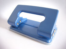Paper Punch. A hole punch used with for filing paper Stock Photos