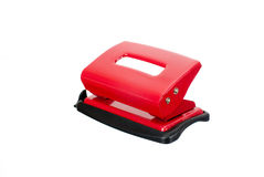 Paper puncher. Red paper puncher on a white isolated background Royalty Free Stock Photography