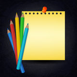 Paper with push pin and colorful pencils on chalkboard Stock Images