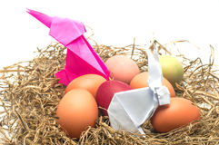 Paper rabbit and egg in next. Easter Stock Photography