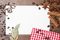 Paper for recipes and spices on wooden table. Paper for recipes, pepper and spices on wooden table Stock Photo