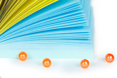 Paper records in block with beads. Paper records in block with orange beads Stock Image