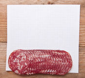 Paper records and  sausage Stock Image