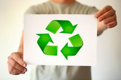 Paper recycle sign in business man hand. Concept Royalty Free Stock Photos