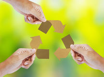 Paper recycle sign in hands Royalty Free Stock Image