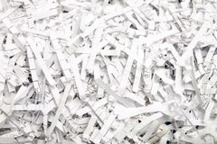 Paper for recycling. Finely chopped by machine stock photo
