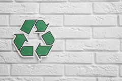 Paper recycling symbol on wall. Space for text. Paper recycling symbol on brick wall. Space for text stock photography
