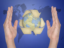 Paper recycling symbol on hand Royalty Free Stock Photos