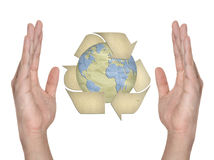Paper recycling symbol on hand Stock Photo