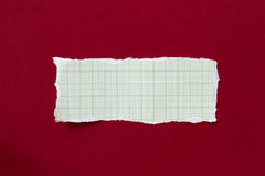 Paper on a red cloth Stock Images