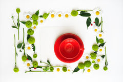 Paper and red cup for coffee or tea with wreath frame. Stock Image