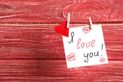 Paper and red heart hanging on rope Royalty Free Stock Photo