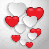 Paper and red hearts Stock Photography