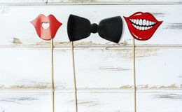Paper Party Accessories. Paper red mouths and black bow tie .Party accessory stock images