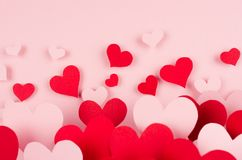 Paper red and pink hearts with blur perspective on soft pink color background. Valentine day concept for design. Paper red and pink hearts with blur perspective Royalty Free Stock Images