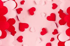 Paper red and pink hearts with blur perspective on soft pink color background. Valentine day concept for design. Paper red and pink hearts with blur perspective Stock Images