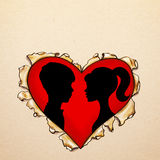 Paper ripped heart with silhouettes stock photo