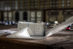 Paper roll. A paper roll left on a desk in the control room of an abandoned power plant stock images