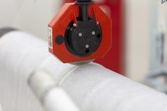 Paper roll machine cutting paper stock photo