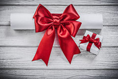 Paper roll with red bow present box holidays concept.  Royalty Free Stock Photography