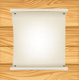 Paper roll sign on wooden background Royalty Free Stock Photos