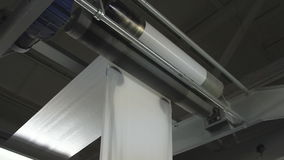 Paper roll unreel for a printing press stock footage