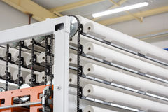 Paper rolls on conveyor. Big paper rolls in paper production factory royalty free stock images