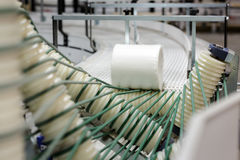 Paper rolls on conveyor. Big paper rolls in paper production factory stock images