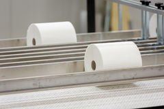 Paper rolls on conveyor. Big paper rolls in paper production factory stock photography