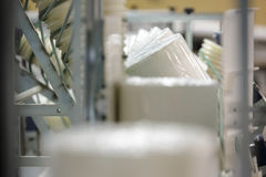 Paper rolls on conveyor. Big paper rolls in paper production factory royalty free stock image