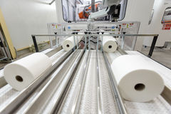 Paper rolls on conveyor. Paper rolls in paper production factory royalty free stock images