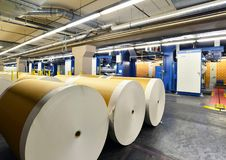 Paper rolls and offset printing machines in a large print shop f. Or production of newspapers & magazines stock images